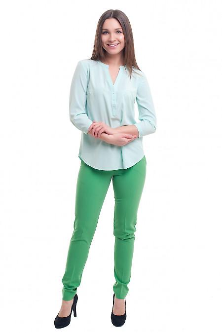 Зелені завужені брюки