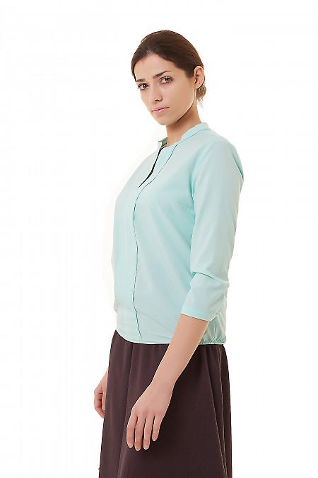 Нежно-бирюзовая блузка просторного кроя