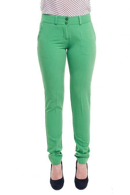 Брюки зелені завужені із вставкою на кишені. Діловий жіночий одяг