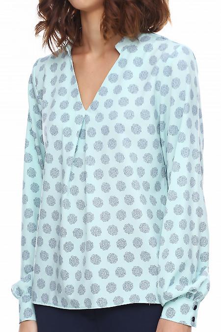 Бирюзовая блузка в цветы