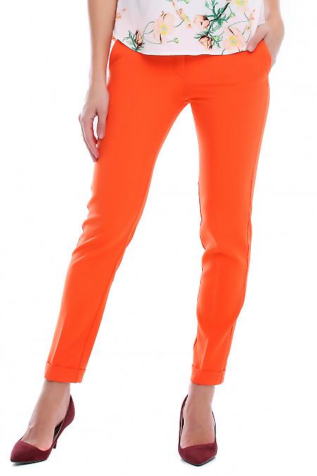 Брюки помаранчеві з манжетом і кишенями. Діловий жіночий одяг