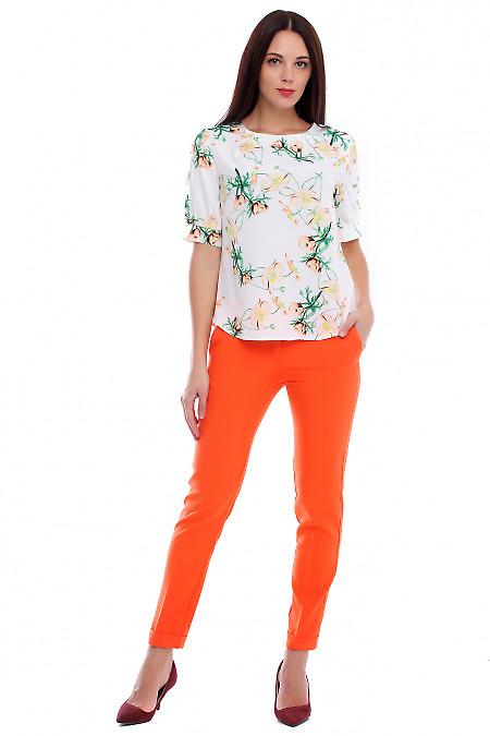 Купить брюки оранжевые с манжетой и карманами. Деловая женская одежда фото