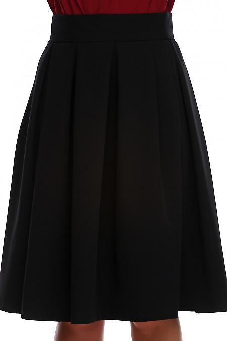 Купить юбку черную в складку с карманами. Деловая женская одежда фото