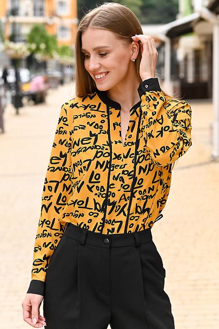 Жіноча блуза жовтого кольору