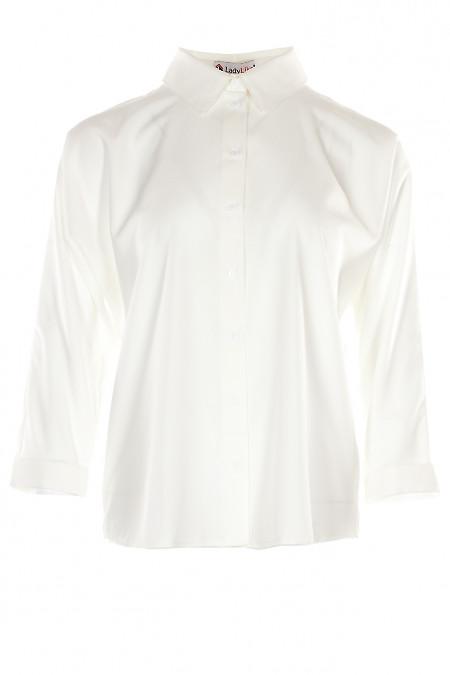 Блузка белая оверсайз с манжетой на рукавах. Деловая женская одежда фото