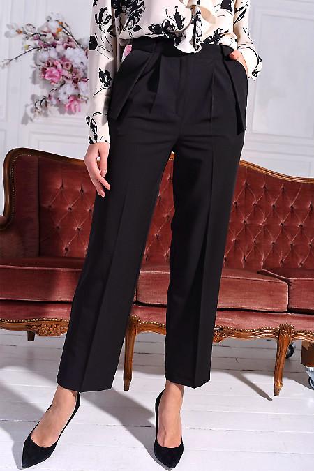 Чорні брюки з кишенями