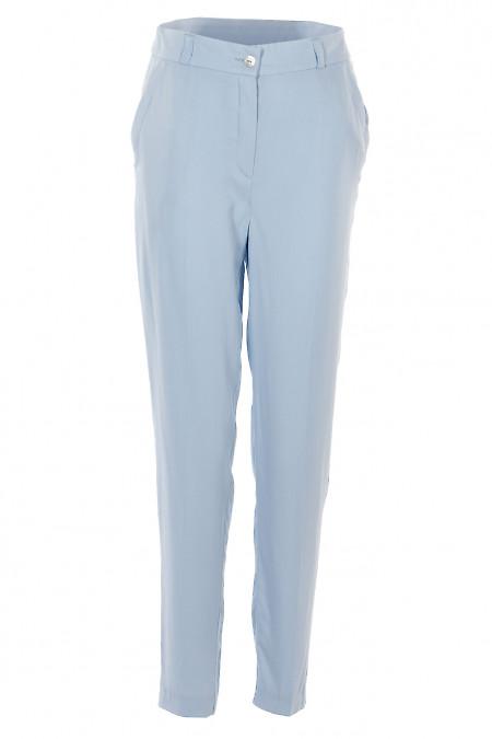 Брюки блакитні завужені з кишенями. Діловий жіночий одяг