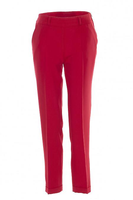 Брюки красные с молнией сбоку. Деловая женская одежда фото