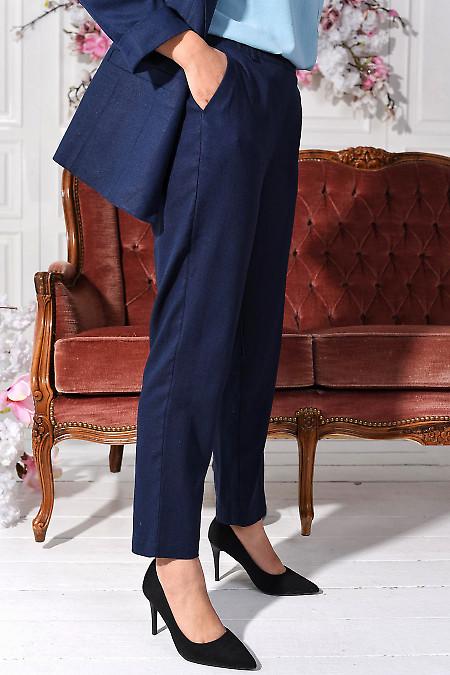 Синие льняные брюки с прорезными карманами