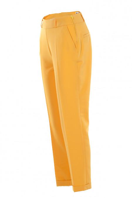 Желтые брюки с карманами