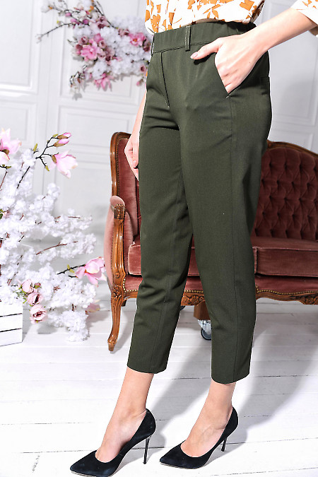 Зелені брюки з кишенями фото