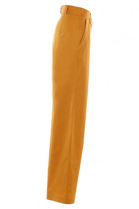 Желтые брюки с высокой посадкой