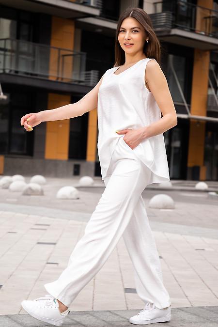 Купити білі жіночі просторі брюки. Жіночий одяг.