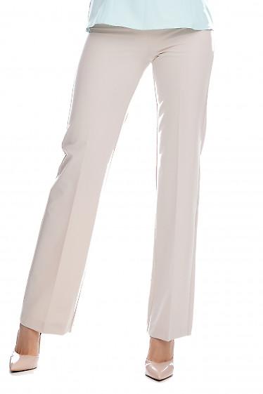Купить брюки бежевые без карманов. Деловая женская одежда фото