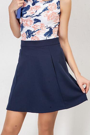 Короткая синяя юбка с кармашками. Деловая женская одежда фото
