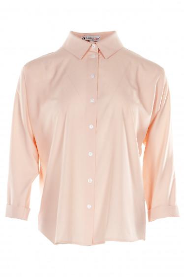 Блузка персиковая оверсайз с манжетой на рукавах. Деловая женская одежда фото