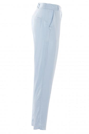 Голубые зауженные брюки