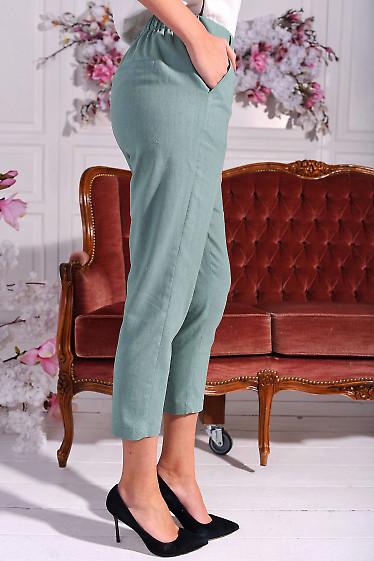 Зауженные оливковые брюки фото