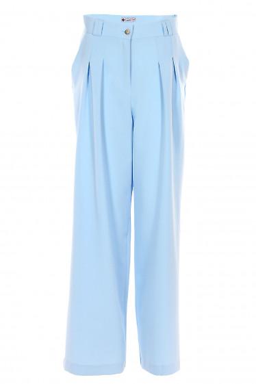 Брюки палаццо голубые. Деловая женская одежда фото
