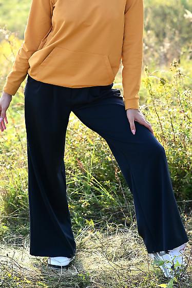 Купить синие брюки палаццо. Деловая женская одежда фото