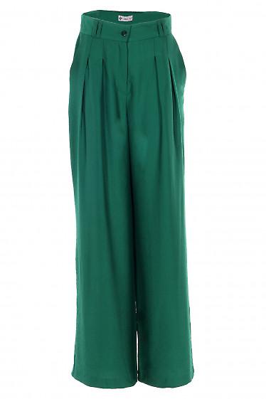 Брюки палаццо зеленые. Деловая женская одежда фото