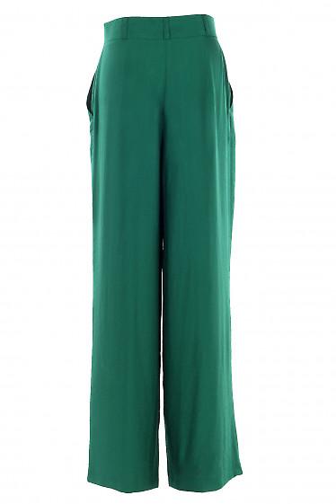 Купить просторные зеленые брюки. Деловая женская одежда фото