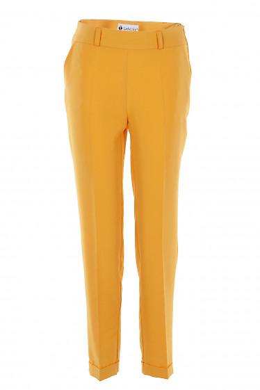 Брюки ярко желтые с молнией сбоку. Деловая женская одежда