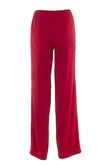 Купить красные женские брюки на резинке. Деловая женская одежда фото